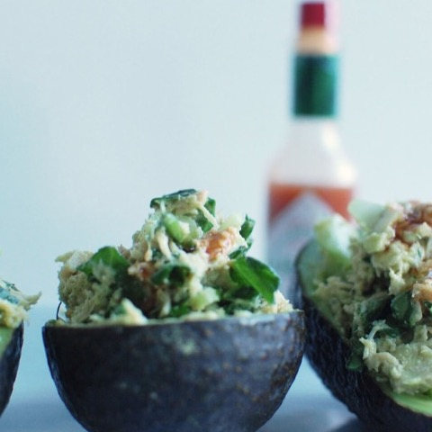 Tuna salad stuffed avocado with hot sauce
